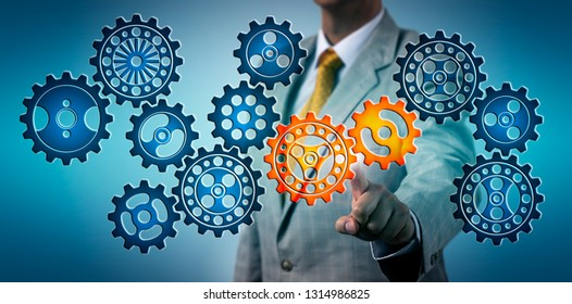 Torso of manager selecting two cog wheels in a virtual gear train. Business concept for idea, engineering solution, innovation, cooperation, collaboration, teamwork, investment, crisis, strategy.