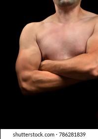 Torso novice bodybuilder closeup on black background