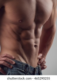 Torso of a perfectly fit man demonstrating abdominal muscles