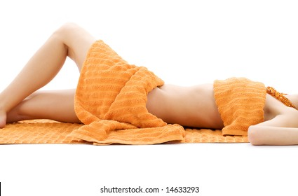 torso of relaxed lady with orange towels over white