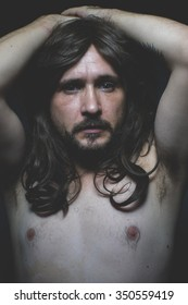 torso sexy naked man with long dark hair, intense eyes and blue eyes