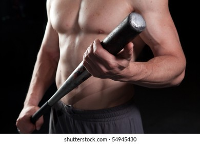 Torso of a shirtless guy holding a baseball bat