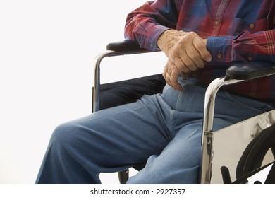 Torso shot of Caucasion elderly man sitting in wheelchair.