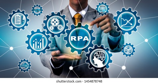 Torso of unrecognizable IT manager activating RPA application in virtual gear train interface. Technology concept for robotic process automation, increased productivity and artificial intelligence.