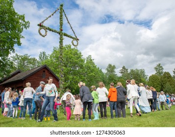 TORSTUNA, SWEDEN - JUNE 19: Unidentified people in folklore ensemble in midsummer event on June 19, 2015 in Torstuna Sweden