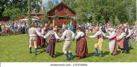 TORSTUNA, SWEDEN - JUNE 19: Unidentified people in folklore ensemble in midsummer event on June 19, 2019 in Torstuna Sweden.