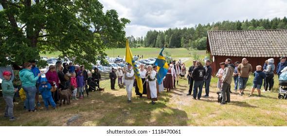 TORSTUNA, SWEDEN - JUNE 22: Unidentified people in folklore ensemble in midsummer event in Torstuna on June 22, 2018 in Torstuna Sweden