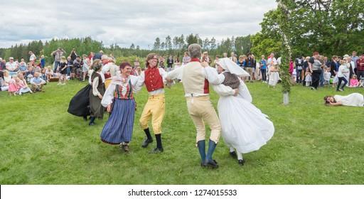 TORSTUNA, SWEDEN -JUNE 23: Unidentified people in folklore ensemble in midsummer event  on June 23, 2017 in Totstuna Sweden.