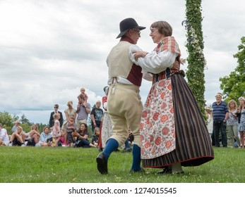 TORSTUNA, SWEDEN -JUNE 23: Unidentified people in folklore ensemble in midsummer event  on June 23, 2017 in Totstuna Sweden.