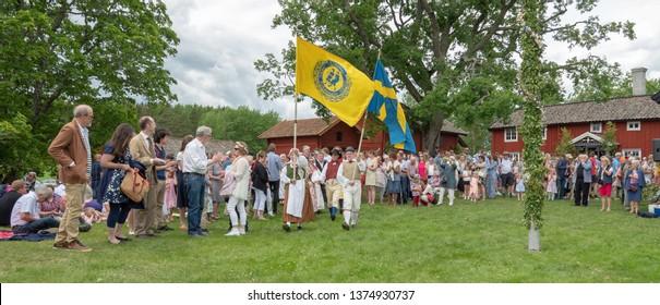 TORSTUNA, SWEDEN - JUNE 23: Unidentified people in folklore ensemble in midsummer event on June 23, 2017 in Torstuna Sweden.