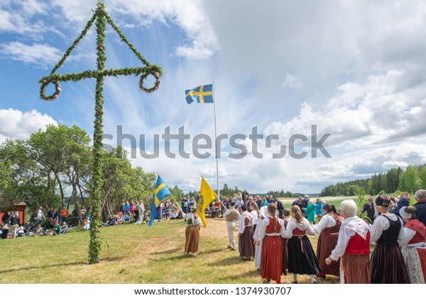 TORSTUNA, SWEDEN - JUNE 23: Unidentified people in folklore ensemble in midsummer event on June 23, 2017 in Torstuna Sweden.