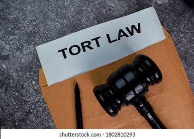 Tort Law text write on a paperwork and gavel isolated on office desk.