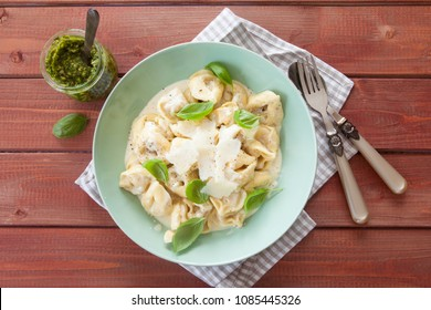 Tortellini in a creamy cheese sauce with fresh basil