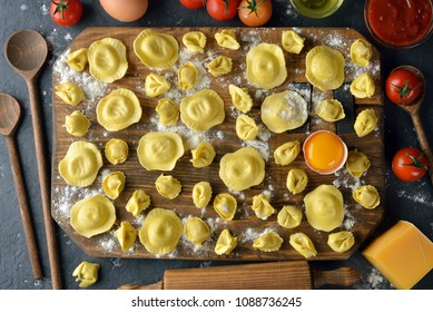 Tortellini and ravioli on a gray background