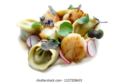 tortellini with scallops and green garnish