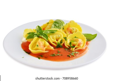 Tortelloni stuffed pasta with cheese and tomato sauce on plate isolated