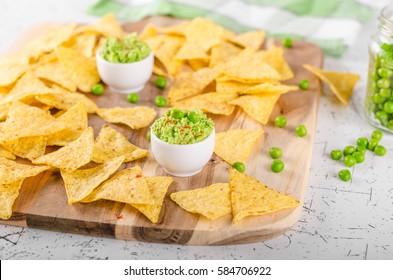 Tortilla chips peas dip, bio peas with little bit of chilli powder