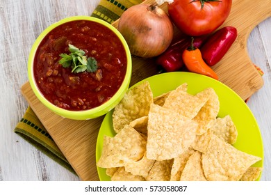 Tortilla chips with salsa and onion, tomato, peppers snack food
