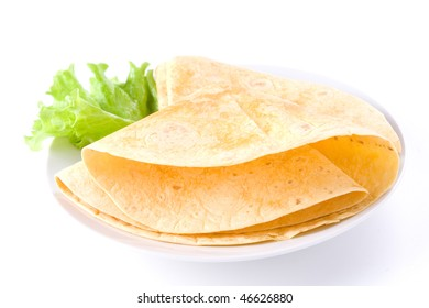 tortilla on white plate with lettuce
