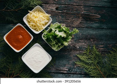 Tortilla sauces with salad on rustic background