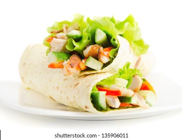 tortilla wraps with chicken and fresh vegetables isolated on white. Selective focus