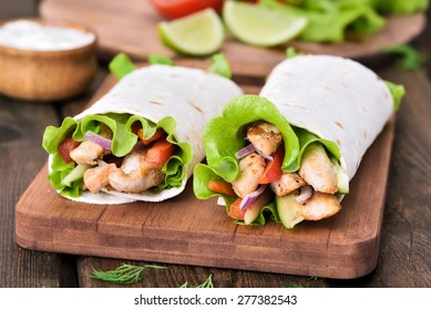 Tortilla wraps with chicken meat and vegetables.