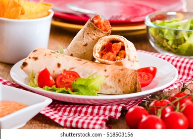 Tortilla wraps with chicken and vegetable.