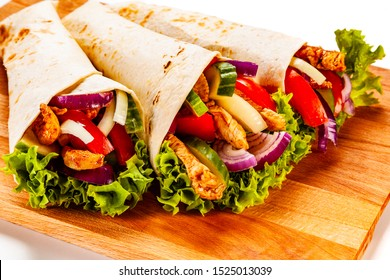 Tortilla wraps on cutting board on white background
