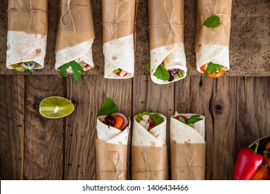 Tortilla wraps with vegetables. Mexican tortillas. Tacos with nachos and vegetables