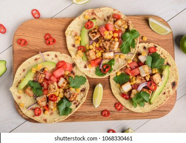 Tortillas with taco filling. Juicy combination of vegetables and tofu. Vegetarian version of well-known Mexican dish.