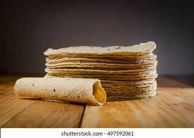 Tortillas and taco on wood table