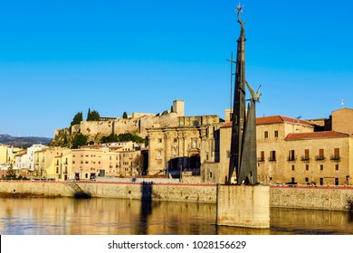TORTOSA, SPAIN - FEBRUARY 7, 2018: The Ebro River and the Monumento a los Caidos en la Batalla del Ebro, a memorial to the dead people on the side of Franco in the Spanish Civil War, in the foreground