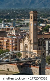 Tortosa, Spain - October 16, 2019: View of the bridge over the Ebro River and the church building. Vertical
