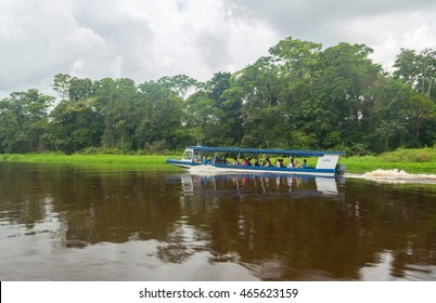 TORTUGUERO, COSTA RICA - MAY 05: Sightseeing boat with unidentified people visiting National Park in Tortuguero, Costa Rica on May 05, 2014. Tortuguero is the third-most visited park in Costa Rica