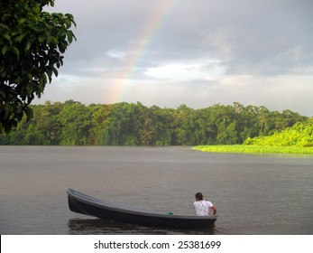 Tortuguero Rainbow - Looking south-west along  main channel from the public dock at Costa Rica's famos ecological preserve.   Note the rainbow .... it rains a lot here.  Taken October 2008