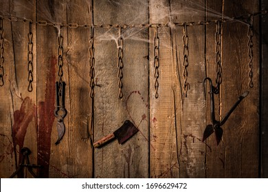 Torture tools on wood background