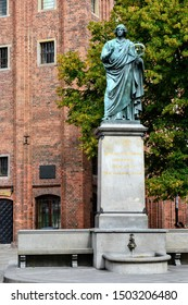 """Torun, Poland - August 12 2019: Latin inscription on the Nicolaus Copernicus Monument. TRANSLATION: """"Nicolaus Copernicus of Torun city, mover of the earth, stopper of the sun and heavens"""""""