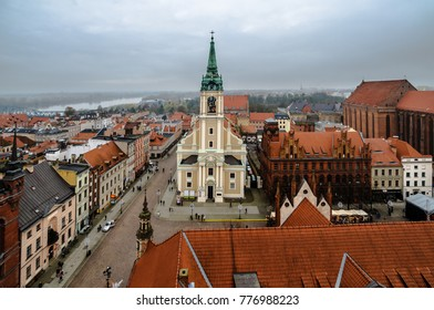 Torun, Poland; Torun, Poland. December 03, 2017; Views on Old Town area from tower of Town Hall with the Holy Spirit Church raised in mid-18th century in the first plan
