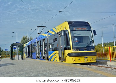 TORUN, POLAND - OCTOBER 1 - The new yellow and blue bi-directional Swing duo tram, produced by Polish company of Pesa, serving the MZK Torun tramway network, on October 1, 2016 in Torun, Poland