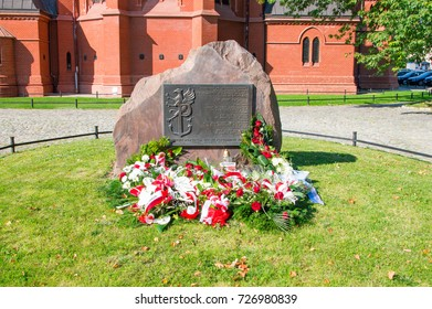Torun, Poland - September 29, 2017: Monument to commanders of Home Army next to Church of St. Catherine in Torun, Poland.