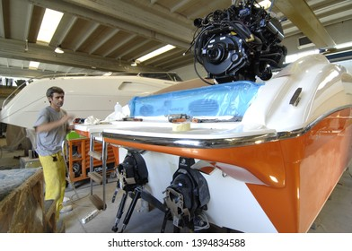 Toscana, Italy- August 20,2008: assembler is working in yacht factory