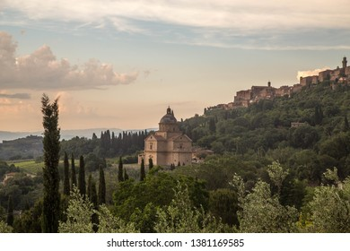 toscany architecture with trees and clouds
