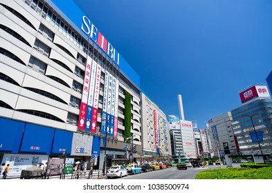 """TOSHIMA, TOKYO / JAPAN - JULY 10 2011 : """"Ikebukuro"""" station east exit scenery. There is """"Seibu Department Store"""" in the station building."""