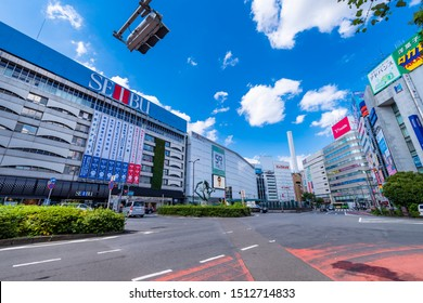 TOSHIMA, TOKYO / JAPAN - SEPTEMBER 19 2019 : The scenery of the east entrance of Ikebukuro Station. There is a department store building and a large roundabout in front of the station.