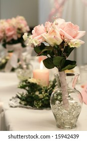 Toss bouquet in glass vase at a reception.