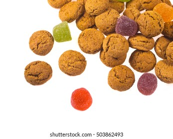 Toss of Pepernoten cookies and sweets seen from above as Sinterklaas decoration on white background for dutch sinterklaasfeest holiday event on december 5th