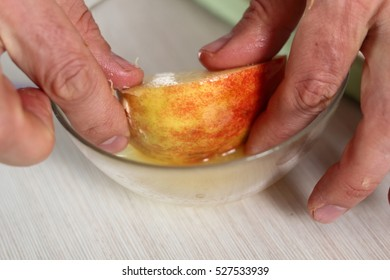 Toss quarters of apples in lemon juice. Making Apple Tarte Tatin with Cinnamon Series.