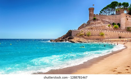 Tossa de Mar, Costa Brava, Catalonia, Spain - September 6, 2016: View of the ancient fortress city of Vila Vella and the beach of the Mediterranean Sea.