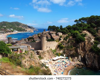TOSSA DE MAR, SPAIN - AUGUST 22: View of the beach in Tossa de Mar, Spain on August 22, 2017. Tossa de Mar is one of the most visited towns in Costa Brava, Girona in the holidays.