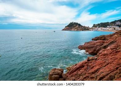Tossa de Mar, Vila Vella and the sandy beach, Costa Brava, Catalonia, Spain. Teal and orange style